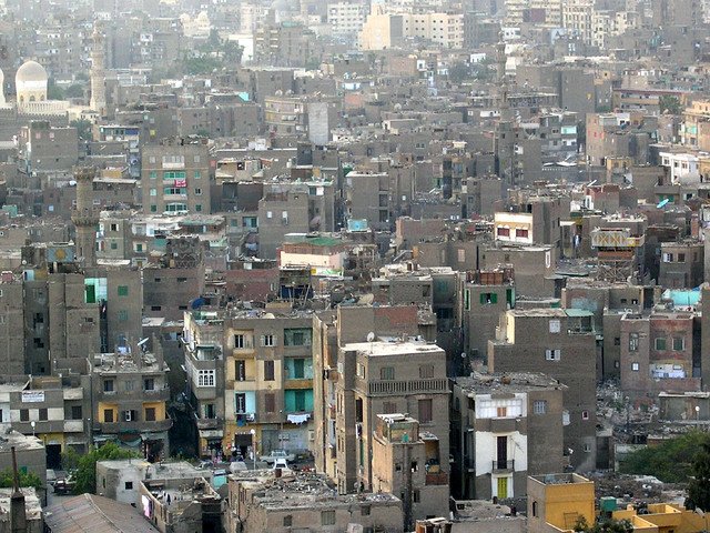 Slum in Old Cairo, Egypt. Between the buildings are streets with piles of solid waste.